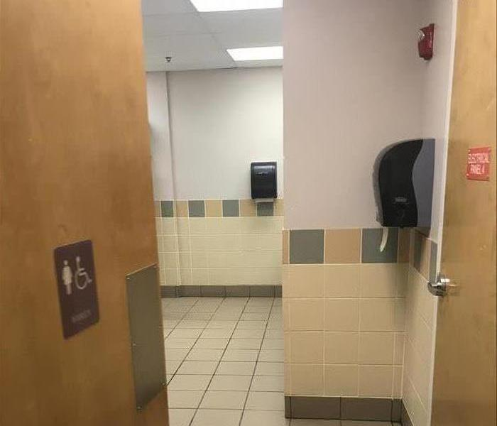 Soot Damage in School Bathroom After